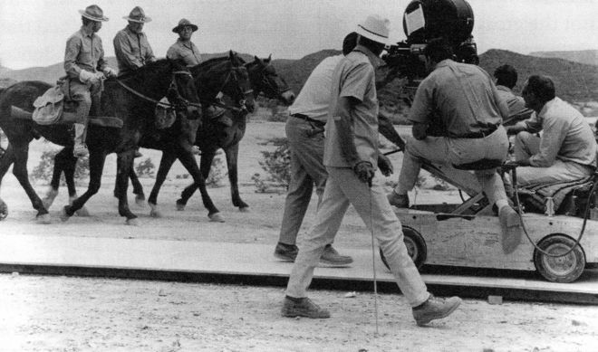 IMAGE: Sam Peckinpah and crew direct the opening scene of The Wild Bunch