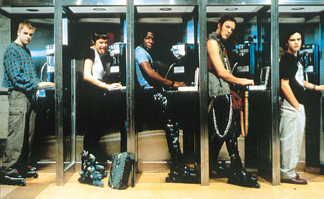 IMAGE: Photograph of the cast from Hackers at phone booths